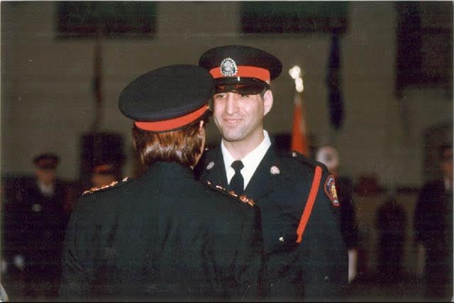 http://www.jpmf.ca/media/John-getting-his-badge-from-Chief-Silverberg.jpg