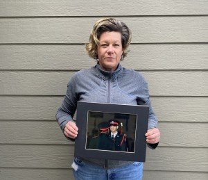 Maryanne Pope holding photo of John Petropoulos