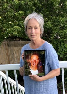 Julie Hamilton holding a photo of her son, Tim