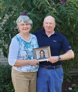 Shirley and Bob Hickman with photo of Tim